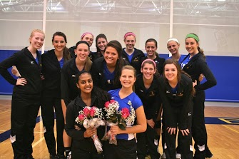 The Varsity Volleyball girls gather before the match to honor their seniors.