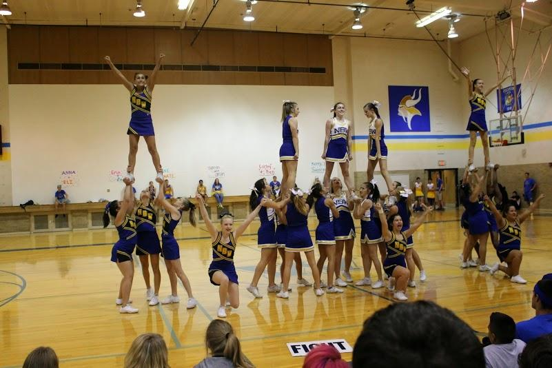 Cheerleaders performing a stunt. They took second place in their division.