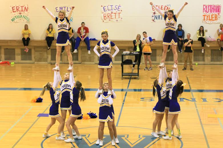 NBW Varsity Cheer preforms at the Pep Rally as students prepare for Crystal Ball.