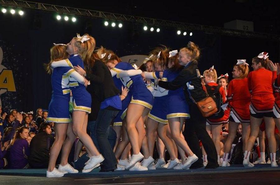 Pictured here is the New Berlin West Cheer team celebrating after taking 1st in their divison at Nationals Qualifiers.
