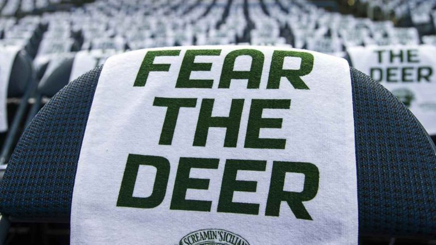 Towels line the seats in BMO Harris Bradley Center with their motto