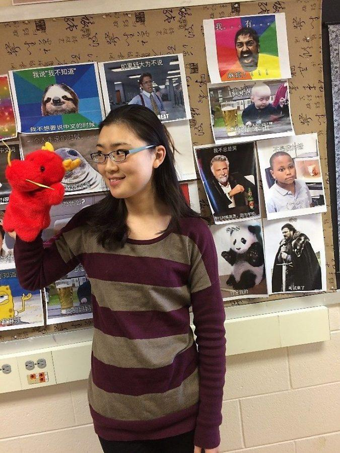 Yuan Yao holds a dragon puppet to celebrate Chinese New Year. She has been teaching at New Berlin West for three years.