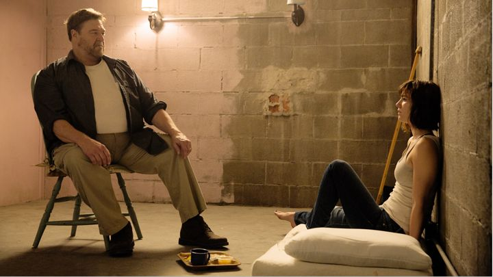 Howard (John Goodman) and Michelle (Mary Elizabeth Winstead) share a tense moment.