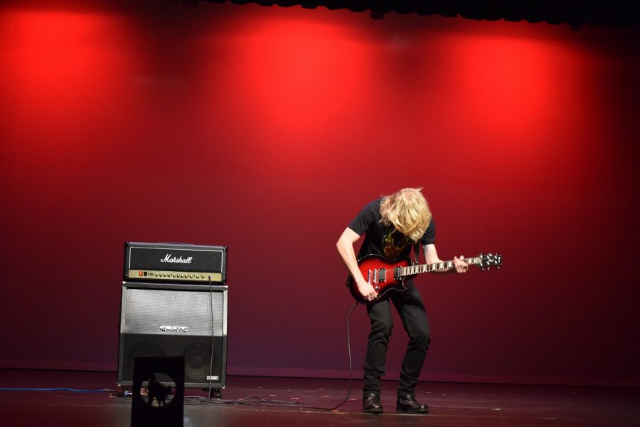 Carter Smith performs a rocking guitar solo of Crazy Train by Ozzy Osbourne and Randy Rhoads. Smith received second place overall in this years talent show.